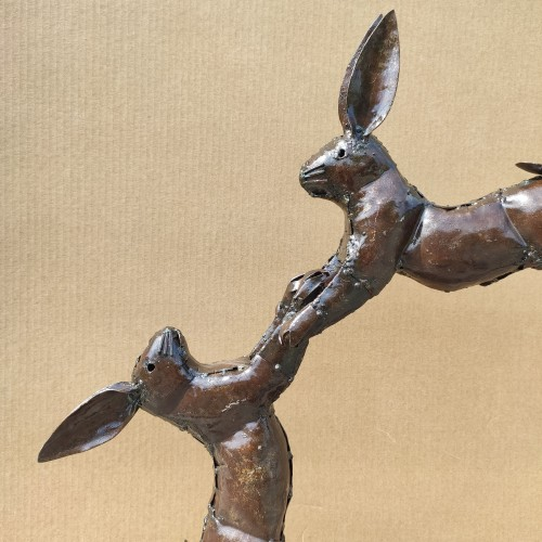 Small boxing hares sculpture